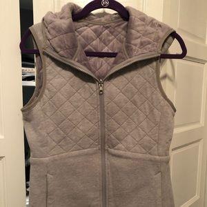 Reversible hooded vest